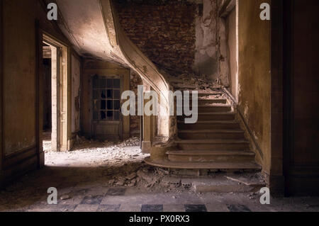 Interior view with a staircase in an abandoned office building in France. - Stock Image