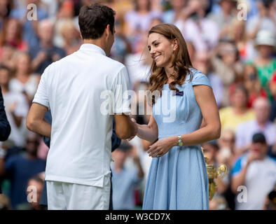 London, UK. 14th July 2019. Wimbledon Tennis Tournament, Day 13, mens singles final; Catherine Duchess of Cambridge talks to Roger Federer (SUI) as he is presented with the losing finalist plate Credit: Action Plus Sports Images/Alamy Live News - Stock Image