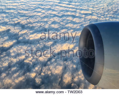 Beautiful pattern of clouds seen from inside a commercial airplane traveling over North America. The beauty of nature in unexpected places - Stock Image