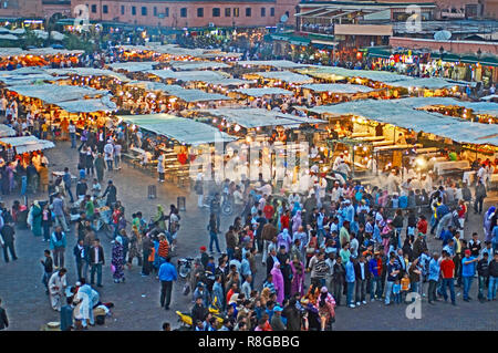 STREET MARKET, JEMAA-EL FNAS, MARRAKECH, MOROCCO. MAY 2011. Medina Old City in the centre of Marrakech in Morocco on an early evening with crowds - Stock Image
