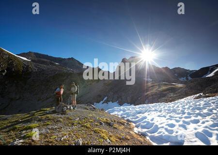 Path to the Piz Cotchen, Sesvenna range between Unterengadin Switzerland and Vinschgau, Italy - Stock Image