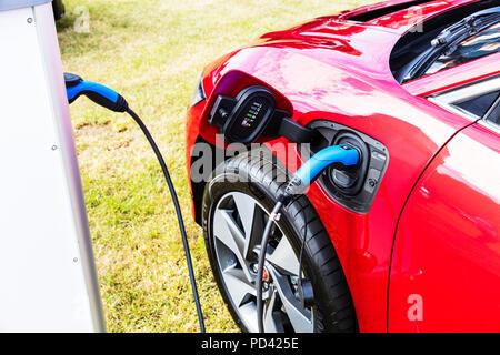 Battery Powered Car, Zero vehicle Emissions, Government Plug-In Car Grant, Plug-In Car Grant, Plug-In Car, electric charge point, electric car charge - Stock Image