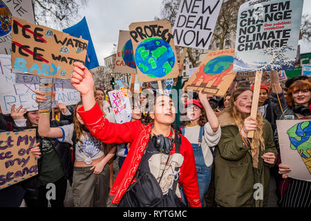 London, UK. 15th Mar 2019. Marching down Whitehall to Downing Street -School students go on strike over the lack of action on climate change. They gather in Parliament square and march on Downing Street, blocking the streets around Westminster for over an hour. Credit: Guy Bell/Alamy Live News - Stock Image