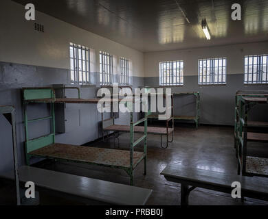 Communal cell in the prison on Robben Island, Cape Town, South Africa, that held political prisoners, such as Nelson Mandela, during the apartheid era - Stock Image