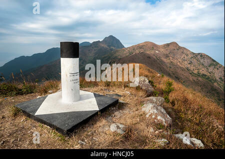 At the summit of Pyramid Hill looking towards Ma On Shan Peak, Ma On Shan Country Park, Hong Kong - Stock Image