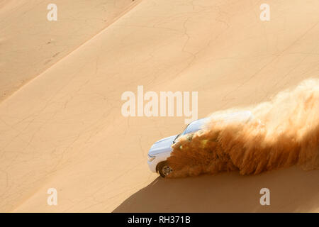 Car driving through desert - Stock Image