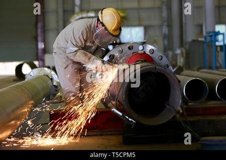 Basra, Iraq. 23rd Apr, 2019. Photo taken on March 1, 2019 shows a welding worker working on a pipeline in China Petroleum Engineering and Construction Corporation (CPECC) Rumaila plant in the southern province of Basra, Iraq. Through the Belt and Road Initiative, the Chinese company can offer financial, technical support and expertise for Iraqi government in reconstructing oil fields and increase their production, said Wang Xianghui, project director of Rumaila in China Petroleum Engineering and Construction Corporation (CPECC). Credit: Khalil Dawood/Xinhua/Alamy Live News - Stock Image
