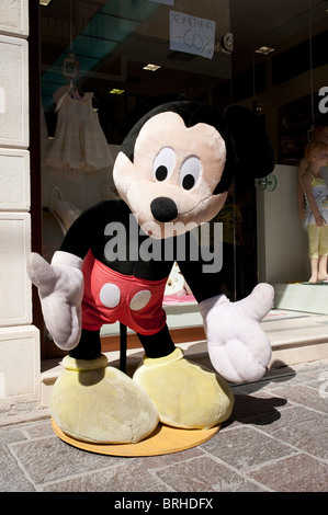 Giant sized Micky Mouse soft toy outside shop Rethymno Crete Greece - Stock Image
