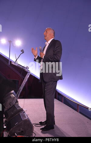 Garden City, New York, USA. June 21, 2018. Former NASA space shuttle astronaut MIKE MASSIMINO, a Long Island native, stands at podium on stage while he gives free lecture in the JetBlue Sky Theater Planetarium at the Cradle of Aviation Museum. - Stock Image