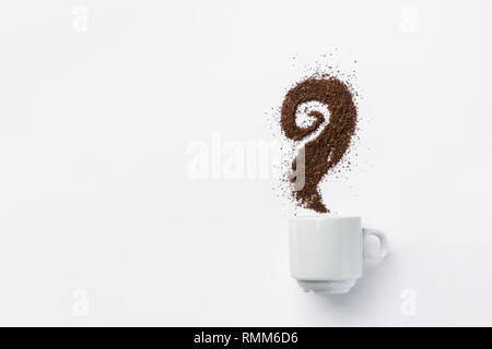 White ceramic cup of coffee with curly steam made from grounds. Creative food artwork. Breakfast energy concept. Design element template for social me - Stock Image