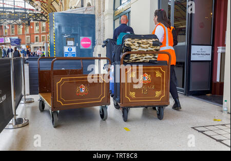 Pullman baggage luggage trollies with suitcases at the entrance to the Belmond Venice Simplon Orient Express departure lounge, London Victoria station - Stock Image