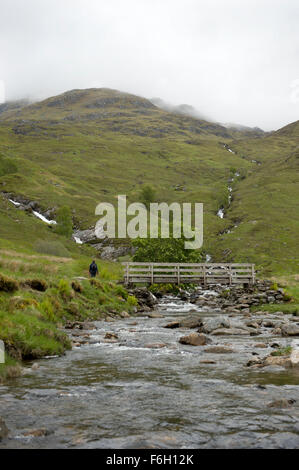 Wooden footbridge over Allt Coire Giubhsachan as it tumbles towards the Water of Nevis.  Built by R E Troop Oxford - Stock Image