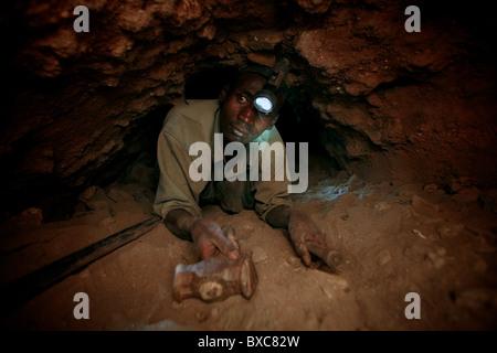 Tanzanite miner mining Mererani  Arusha tanzania - Stock Image