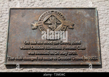 A plaque commemorating the centenary 1909 – 2009 of Dundee United Football Club on Caird Hall wall formally the site of The Crown Hotel in Dundee, UK - Stock Image