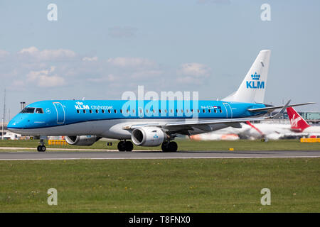 KLM Cityhopper Embraer ERJ-190 aircraft, registration PH-EZA, preparing for take off at Manchester Airport, England. - Stock Image