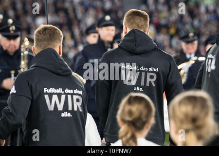 Marco REUS (left, GER) and Niklas SUELE (Svºle, GER) are wearing a jacket with the inscription 'Football, that's all of us', Feature, general, Random motif, Football Laender match, Friendly match, Germany (GER) - Serbia (SRB ) 1: 1, on 20.03.2019 in Wolfsburg/Germany. ¬ | usage worldwide - Stock Image