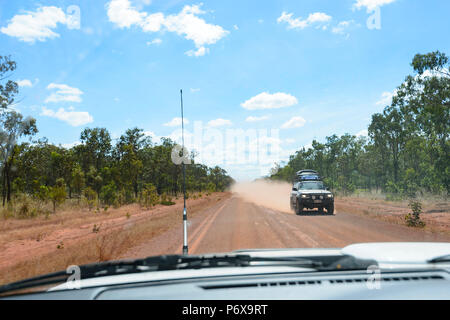 Red dust flying behind an incoming car on the Peninsula Development Road (PDR), Cape York Peninsula, Far North Queensland, FNQ, QLD, Australia - Stock Image