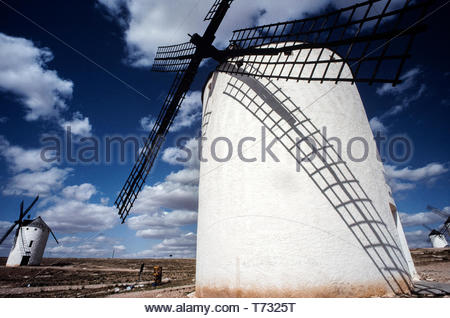 Spain La Mancha. Windmill of Don Quixote country. 2000 Most Spanish windmills, like those described in Cervantes's Don Quixote, can be found in the community of Castilla-La Mancha, in central Spain. The best examples of restored Spanish windmills may be found in Consuegra where several mills spike the hill just outside town, giving a view of the 12th-century castle and of the town. - Stock Image