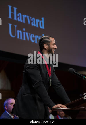 Hutchins Center, Harvard University, Cambridge, MA, USA. 11th Oct 2018. Colin Kaepernick during the 2018 W.E.B Du Bois medal ceremony at Harvard University in Cambridge, Massachusetts, USA.   Kaepernick, a former NFL quarterback for  the San Francisco 49ers became an American icon after keeling during the U.S. National anthem in protest of Police violence against black Americans.  Photo shows Kaepernick on stage in the Sanders Theatre after receiving the Du Bois Medal. Credit: Chuck Nacke/Alamy Live News - Stock Image