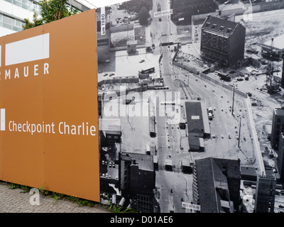 A display on the site of Checkpoint Charlie showing the former border crossing between east and west Berlin Germany - Stock Image