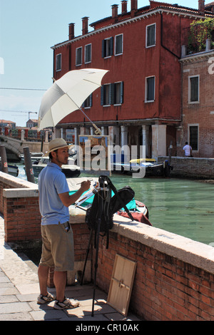 Painter in Venice, Italy - Stock Image