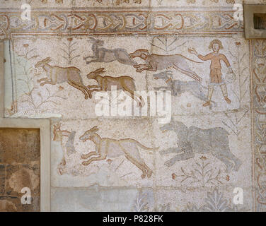 Syria. Bosra (Busra al-Sham). Daraa District. Roman mosaic, 6th century, discovered in the Theatre. Scene of hunting (dogs chasing hare). - Stock Image