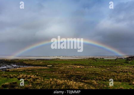 Ardara, County Donegal, Ireland. 20th March 2019. A rainbow appears on a day of sunshine and showers on the north-west coast. Credit: Richard Wayman/Alamy Live News Credit: Richard Wayman/Alamy Live News - Stock Image
