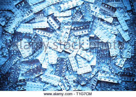 Many empty blister packages on white background, drug overdose, misuse or addiction concept - Stock Image