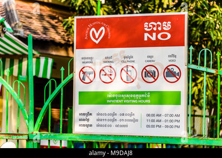 Sign at Siem Reap Children's Hospital, warning visitors of banned items and activities, Siem Reap, Cambodia - Stock Image