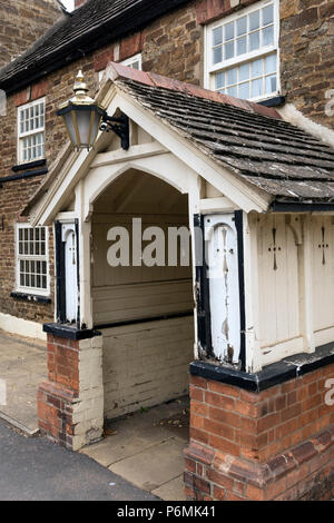 Old entrance porch of Odd House Tavern Pub (now closed down) Oakham, Rutland, England, UK. See Alamy K49G3J for photo before closure. - Stock Image