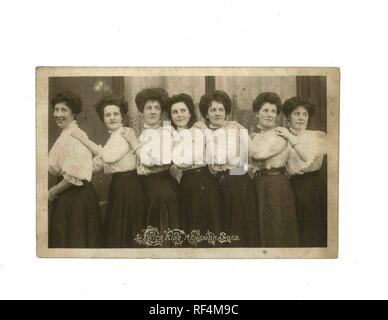 Vintage black and white photo of women possibly in 1900s uniform - Social History - Stock Image