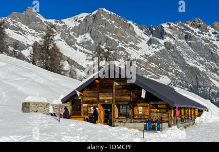 Mountain inn Loutze in winter, Ovronnaz, Valais, Switzerland - Stock Image