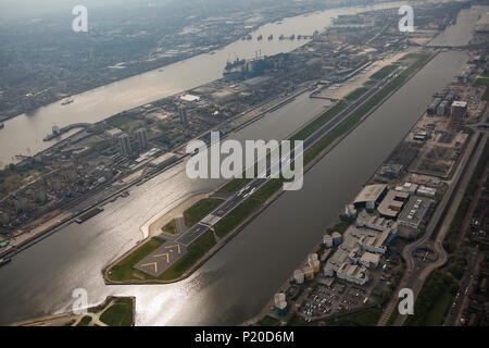 An aerial view of London City Airport on a hazy summer day - Stock Image