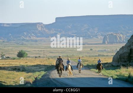 Navajo riders on road to Salina, during, south of Cottonwood Chapter House, Navajo Indian Nation, Arizona, USA - Stock Image