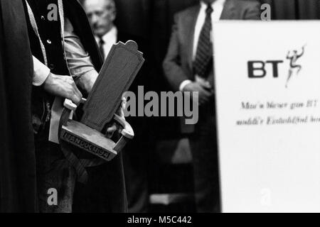 Chaired bard receiving prize on stage at small eisteddfod sponsored by BT in village hall at Llandudoch St Dogmaels - Stock Image