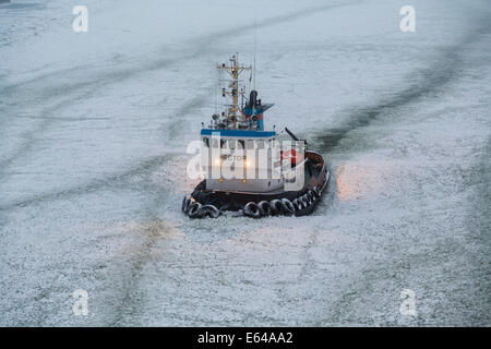 Tug boat & ice in Helsinki harbour, Helsinki, Finland - Stock Image