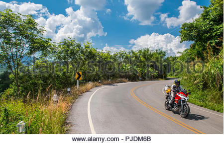 Biker on adventure motorcycle ride, Nan, Thailand - Stock Image