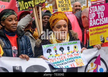 London, UK. 16th March 2019. Zita Holbourn holds up an artwork at the front of the march. Thousands march through London on UN Anti-Racism day to say 'No to Racism, No to Fascism' and that 'Refugees Are Welcome Here', to show solidarity with the victims of racist attacks including yesterdays Christchurch mosque attack and to oppose Islamophobic hate crimes and racist policies in the UK and elsewhere. The marchers met in Park Lane where there were a number of speeches before marching to a rally in Whitehall. Marches took place in other cities around the world including Glasgow and Cardiff. Pete - Stock Image