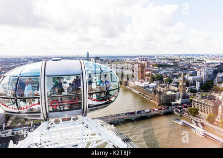 On London Eye, Houses Of Parliament from London Eye, London eye capsule, Top of London eye, London eye wheel, tourists on London Eye, London UK riding - Stock Image