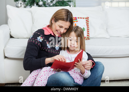 Mother And Daughter With Letter - Stock Image