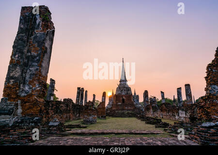 Ruins and pagoda ancient architecture of Wat Phra Si Sanphet old temple famous attractions during sunset at Ayutthaya - Stock Image