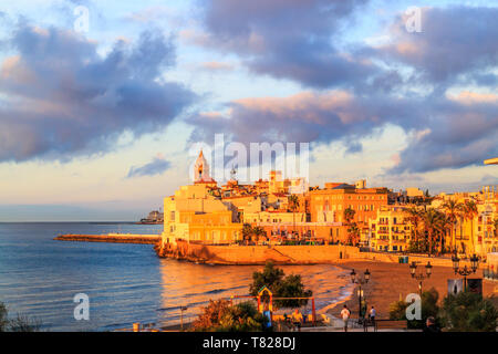 View of Sitges, Spain basking in the early morning sunshine - Stock Image