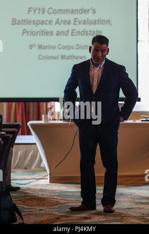 U.S. Marine Corps Col. Kevin W. Matthews, commanding officer of the 8th Marine Corps District, provides his intent for the upcoming fiscal year during the 8412 Symposium in Galveston, Texas August 28, 2018. The Symposium brings 8th Marine Corps District career recruiters together to develop the mind, body and spirit of the individual career recruiter through sustainment training and advanced practices. (U.S. Marine Corps Photo by Sgt. Clarence A. Leake) - Stock Image