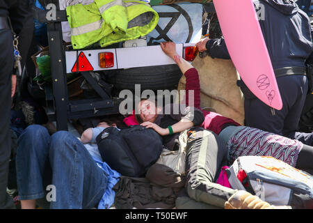 Oxford Circus, London, UK. 19th Apr, 2019. Environmental activists glued themselves under the pink yacht. According to the Met Police, nearly 700 activists have been arrested since the demonstration started on 11 April 2019. Credit: Dinendra Haria/Alamy Live News - Stock Image