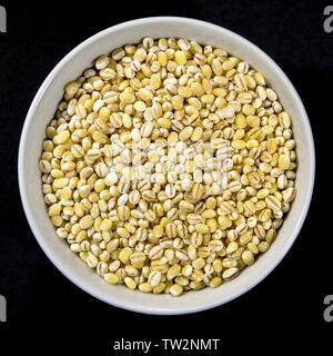 Bowl of Natural Healthy Pearl Barley Cooking Ingredient - Stock Image
