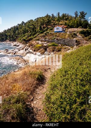 Thasos island cliffs and small church near the Thasos Acropolis and island main city Limenas - Stock Image