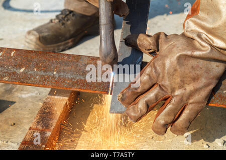 Plasma cutting for workpieces. Sparks during cutting of metal manual plasma cutting machine. - Stock Image