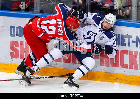 Moscow, Russia. 21st Mar, 2019. MOSCOW, RUSSIA - MARCH 21, 2019: HC CSKA Moscow's Jannik Hansen (L) and HC Dynamo Moscow's Juuso Hietanen in action in Leg 5 of their 2018/19 KHL Western Conference semi-final playoff tie, at CSKA Arena. Mikhail Tereshchenko/TASS Credit: ITAR-TASS News Agency/Alamy Live News - Stock Image