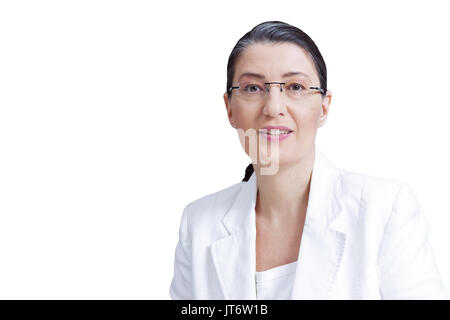 Middle aged woman with eyeglasses in white blazer isolated on white background, professor, teacher, tutor, personal coach, counselor, psychologist - Stock Image