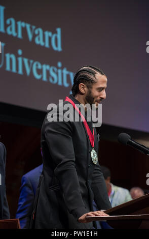 Hutchins Center, Harvard University, Cambridge, MA, USA. 11th Oct 2018. Colin Kaepernick during the 2018 W.E.B Du Bois medal ceremony at Harvard University in Cambridge, Massachusetts, USA.   Kaepernick, a former NFL quarterback for  the San Francisco 49ers became an American icon after keeling during the U.S. National anthem in protest of Police violence against black Americans.  Photo shows Kaepernick on stage in the Sanders Theatre after receiving the Du Bois Medal. - Stock Image
